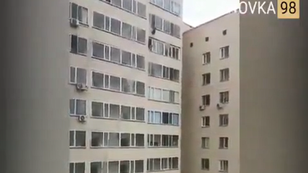 28-year-old Astana man Artem Yarev reaches for a seven-year-old boy dangling from the apartment window above him in Kazakhstan's capital, Sept 24, 2018 - Sputnik International