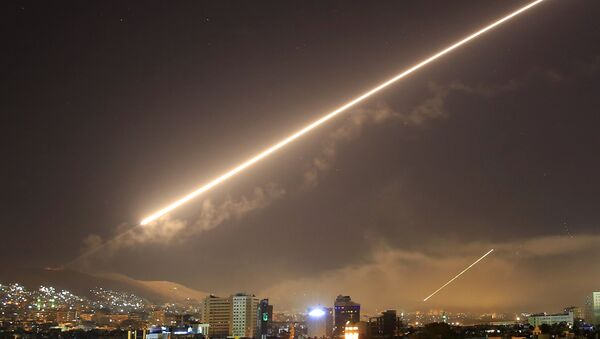In this April 14, 2018 file photo, Damascus skies erupt with surface to air missile fire as the U.S. launches an attack on Syria targeting different parts of the Syrian capital Damascus, Syria - Sputnik International