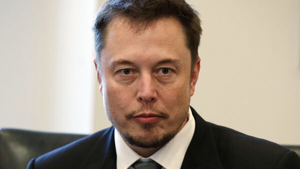 In this Dec. 14, 2016, file photo, Tesla CEO Elon Musk listens as President-elect Donald Trump speaks during a meeting with technology industry leaders at Trump Tower in New York. - Sputnik International