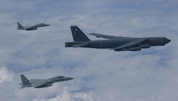 US B-52 bomber flies across East China Sea with two Koku Jieitai (Japan Air Self-Defense Force) F-15 fighters - Sputnik International