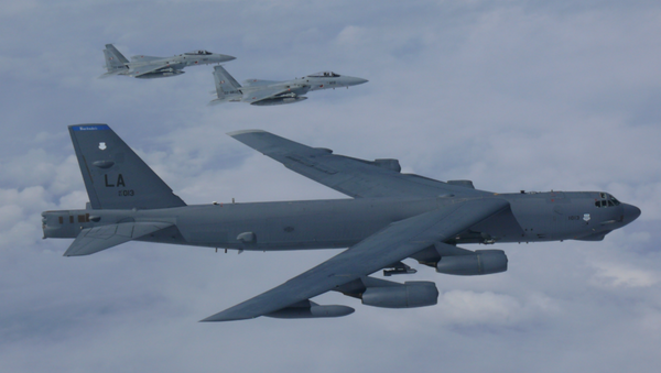 A B-52H Stratofortress bomber aircraft integrated with the Koku Jieitai (Japan Air Self Defense Force) while conducting a routine training mission in the East China Sea and Sea of Japan Sep. 26, 2018 - Sputnik International