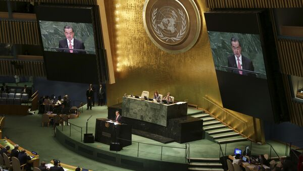 China's Foreign Minister Wang Yi addresses the 73rd session of the United Nations General Assembly, at U.N. headquarters, Friday, Sept. 28, 2018 - Sputnik International