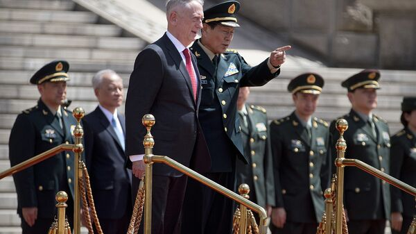 U.S. Defense Secretary Jim Mattis, center left, and China's Defense Minister Wei Fenghe stand together during a welcome ceremony at the Bayi Building in Beijing, Wednesday, June 27, 2018 - Sputnik International