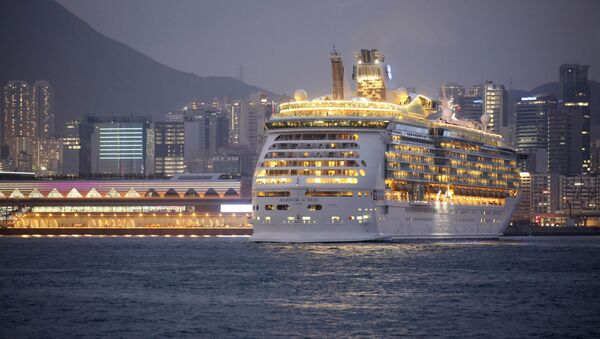 FILE - In this Wednesday, June 12, 2013, file photo, the Mariner of the Seas, right, one of the Voyager-class vessels of Royal Caribbean International, docks at Kai Tak Cruise Terminal in Hong Kong's Victoria Harbor. Royal Caribbean Cruises reports quarterly financial results before the market open on Monday, Jan. 27, 2014. - Sputnik International