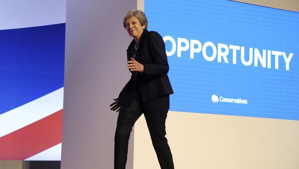 Conservative Party Leader and Prime Minister Theresa May dances as she arrives on stage to address delegates during a speech at the Conservative Party Conference at the ICC, in Birmingham, England, Wednesday, Oct. 3 , 2018. - Sputnik International