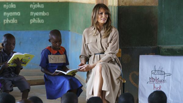 First lady Melania Trump helps a student as she visits a language class at Chipala Primary School, in Lilongwe, Malawi, Thursday, Oct. 4, 2018. Mrs. Trump is visiting Africa on her first big solo international trip, aiming to make child well-being the focus of a five-day, four-country tour. - Sputnik International