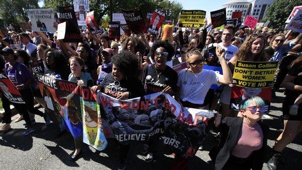 Protesters against Supreme Court nominee Brett Kavanaugh march towards the Supreme Court in Washington, Thursday, Oct. 4, 2018. - Sputnik International