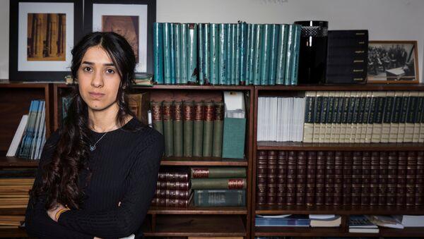 Yazidi survivor Nadia Murad poses for a portrait at United Nations headquarters in New York, U.S., March 9, 2017 - Sputnik International