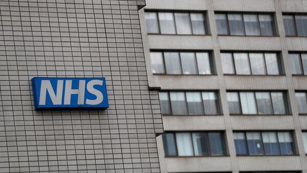FILE PHOTO: NHS sign is seen at St Thomas' Hospital in central London - Sputnik International