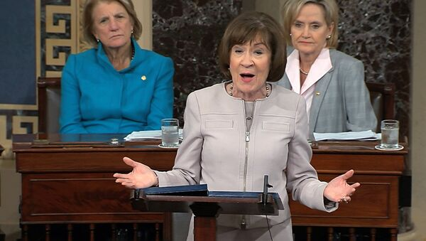 Sen. Susan Collins, R-Maine., speaks on the Senate floor about her vote on Supreme Court nominee Judge Brett Kananaugh, Friday, Oct. 5, 2018 in the Capitol in Washington. Sen Shelly Capito, R-W.Va., sits rear left and Sen. Cindy Hyde-Smith, R-Miss., sits right. (Senate TV via AP) - Sputnik International
