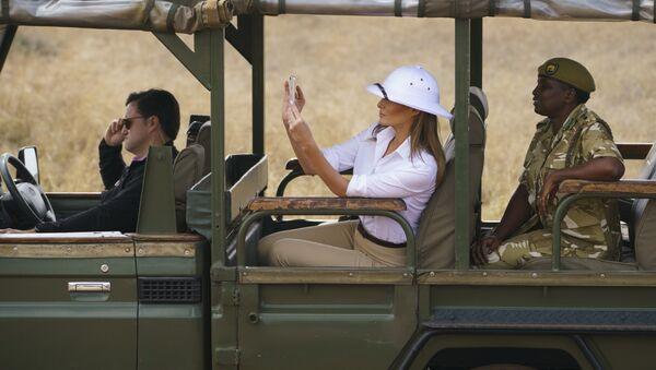 First lady Melania Trump takes photos with her cell phone during a safari at the Nairobi National Park in Nairobi, Kenya, Friday, Oct. 5, 2018 - Sputnik International