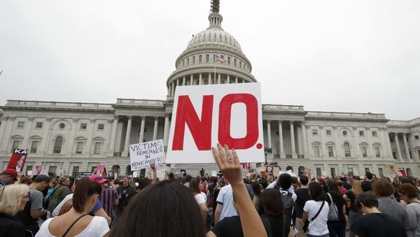 Activists demonstrate in the plaza of the East Front of the U.S. Capitol to protest the confirmation vote of Supreme Court nominee Brett Kavanaugh on Capitol Hill, Saturday, Oct. 6, 2018 in Washington - Sputnik International