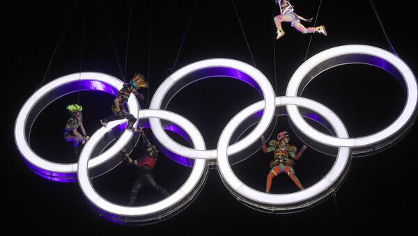 Actors perform high up in the air, inside the Olympic rings during the Opening Ceremony of The Youth Olympic Games, in Buenos Aires, Argentina, Saturday, Oct. 6, 2018. - Sputnik International