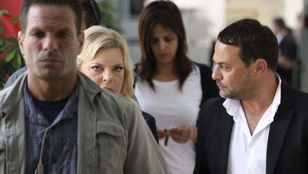 Sara Netanyahu, wife of Israeli Prime Minister Benjamin Netanyahu, second left, arrives to a court hearing in a fraud trial against her, at the Magistrate court in Jerusalem, Sunday, Oct. 7, 2018 - Sputnik International