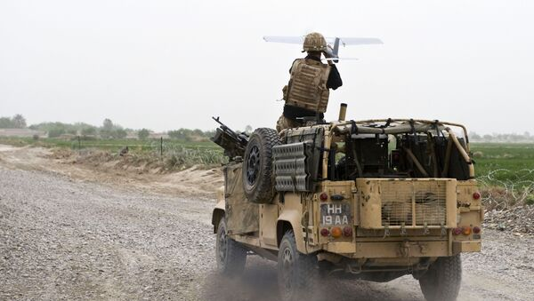 A soldier of Bravo Company, 1 Rifles launches a Desert Hawk UAV (Unmanned Aerial Vehicle) from a WMIK Landrover during an operation near Garmsir, Afghanistan. - Sputnik International
