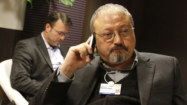 Saudi journalist Jamal Khashoggi speaks on his cellphone at the World Economic Forum in Davos, Switzerland. Khashoggi was a Saudi insider. He rubbed shoulders with the Saudi royal family and supported its efforts to nudge the entrenched ultraconservative clerics to accept reforms. He was a close aide to the kingdom's former spy chief and was a leading voice in the country's prominent dailies - Sputnik International