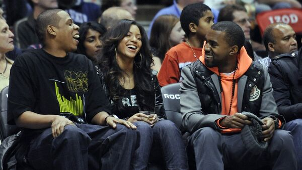 Entertainers Jay-Z, left, Beyonce and Kanye West, right, laugh during the New Jersey Nets' NBA basketball game against the Seattle SuperSonics on Wednesday night, Jan. 9, 2008, in East Rutherford, N.J. - Sputnik International