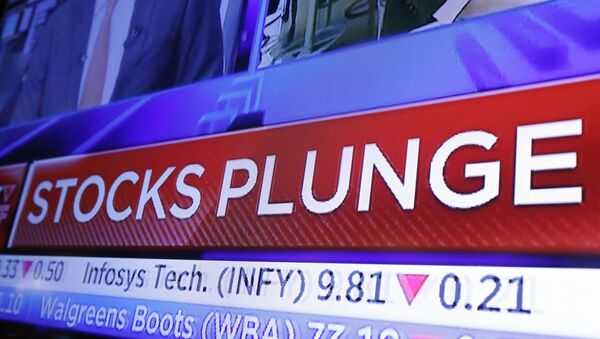 A headline scrolls on a television screen on the floor of the New York Stock Exchange, Wednesday, Oct. 10, 2018. Stocks are extending their slump on Wall Street, led by drops in big technology companies, as rising bond yields draw investors out of stocks.  - Sputnik International