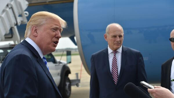US President Donald Trump speaks to the press before making his way to board Air Force One on May 4, 2018 at Andrews Air Force Base, Maryland as he heads to Dallas, Texas to address the National Rifle Association Leadership Forum. Shown (C) is White House Chief of Staff John Kelly. - Sputnik International
