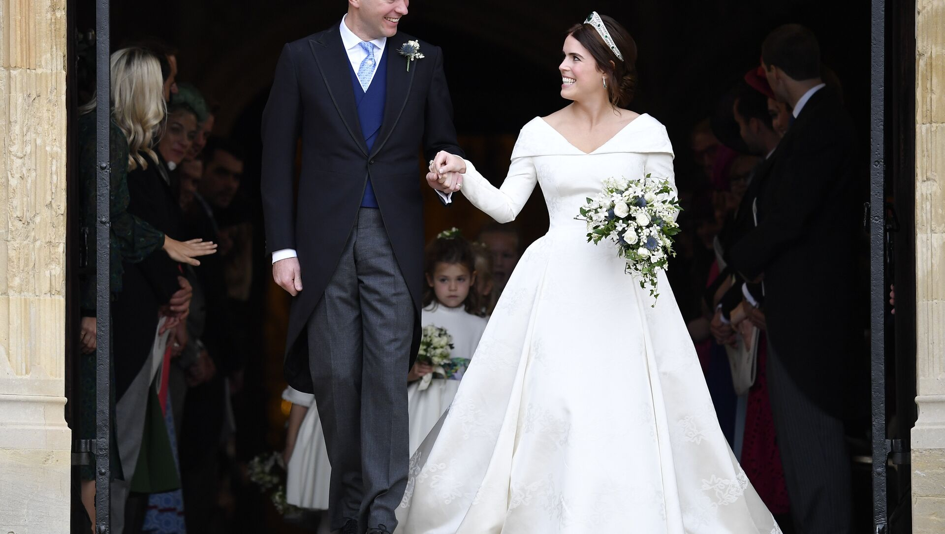 Britain's Princess Eugenie and Jack Brooksbank leave St George's Chapel after their wedding at Windsor Castle, near London, England, Friday Oct. 12, 2018. - Sputnik International, 1920, 01.08.2021