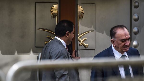 A Saudi official opens the door of the Saudi Arabian consulate in Istanbul on October 8, 2018 in Istanbul during a demonstration for missing journalist Jamal Khashoggi. - Sputnik International