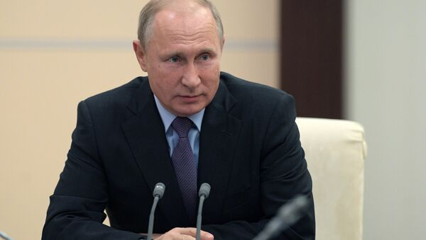Russian President Vladimir Putin during a meeting with permanent members of Russia's Security Council on October 12, 2018 - Sputnik International