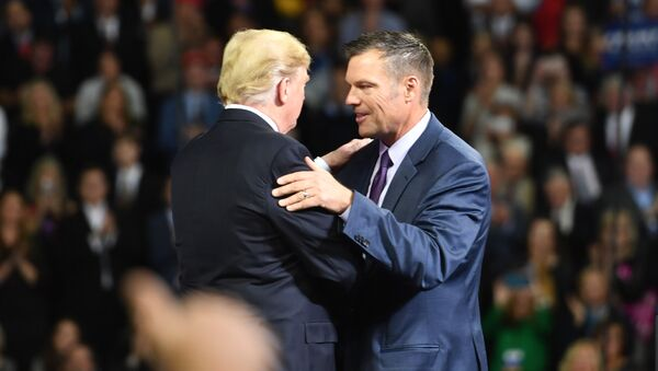 US President Donald Trump (L) greets Kansas gubernatorial candidate Kris Kobach during a Make America Great Again rally in Topeka, Kansas, on October 6, 2018. - Sputnik International