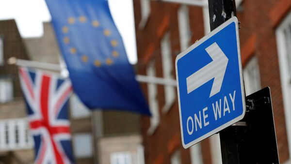 A traffic sign is seen in front of European and Union flags in London, Britain - Sputnik International