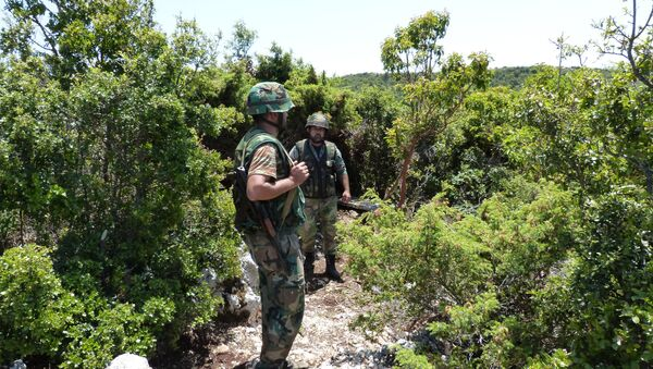 Syrian troops carrying out operations against militants in Latakia. - Sputnik International