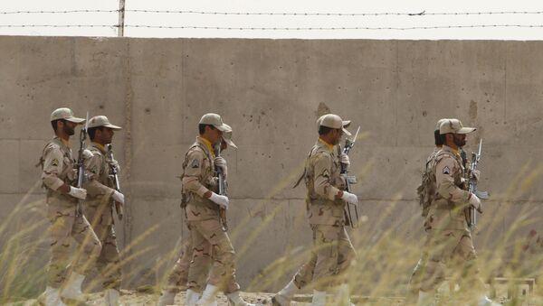 Iranian soldiers keep watch at a drug trafficking patrol post in Milak, southeastern Iran, near the Afghan border, on July 19, 2011 - Sputnik International