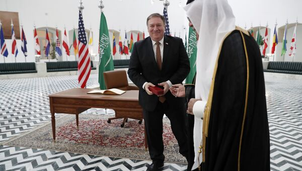 US Secretary of State Mike Pompeo receives a gift during a visit to the Saudi capital Riyadh, on October 16, 2018. Pompeo held talks with Saudi King Salman seeking answers about the disappearance of journalist Jamal Khashoggi, amid US media reports the kingdom may be mulling an admission he died during a botched interrogation. - Sputnik International