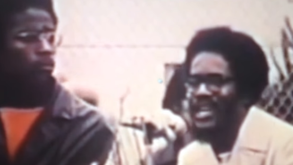 Walter Rodney, at right, speaks to a crowd in San Francisco, California, on African Liberation Day, May 25, 1972 - Sputnik International