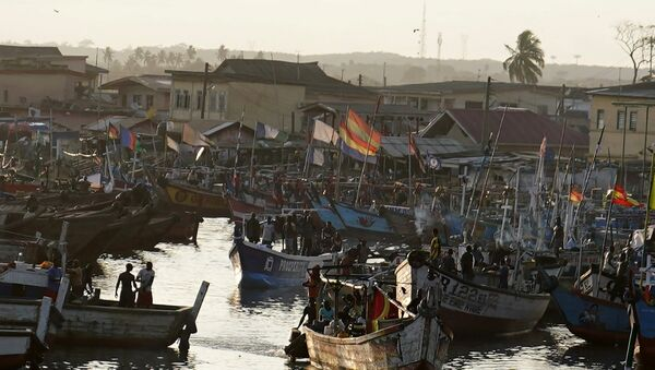 Fishing boats sit in the harbor as the motorcade that carries the media covering US first lady Melania Trump passes in Accra, Ghana, October 2, 2018. - Sputnik International