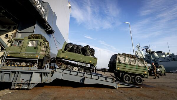 The Dutch marine vessel Hr. Ms. Johan de Witt is loaded with vehicles and goods in Den Helder on October 15, 2018. The amphibious transport ship will participate in the NATO exercise Trident Juncture in Norway. - Sputnik International