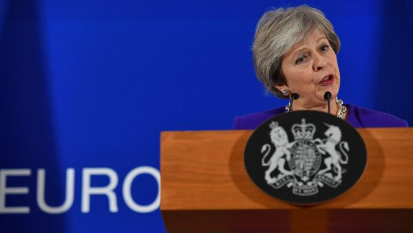 Britain's Prime Minister Theresa May addresses a press conference on the sidelines of a EU summit at the European Council in Brussels on October 18, 2018. - Sputnik International