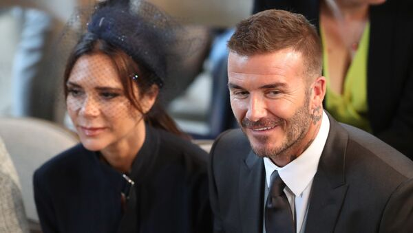 David and Victoria Beckham take their seats in St George's Chapel before the wedding ceremony of Britain's Prince Harry, Duke of Sussex and US actress Meghan Markle in St George's Chapel, Windsor Castle, in Windsor, on May 19, 2018.  - Sputnik International