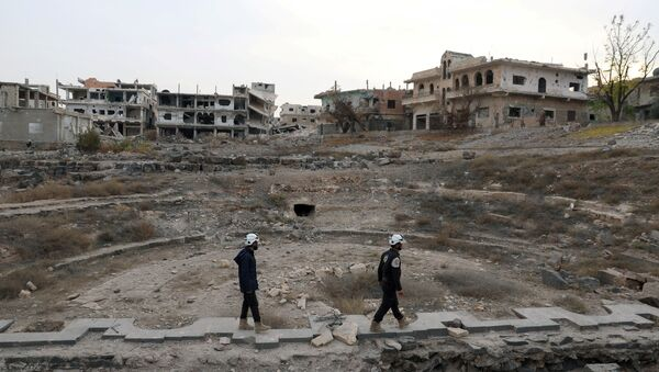 Members of the Civil Defence, also known as the 'White Helmets', are seen inspecting the damage at a Roman ruin site in Daraa, Syria (File) - Sputnik International