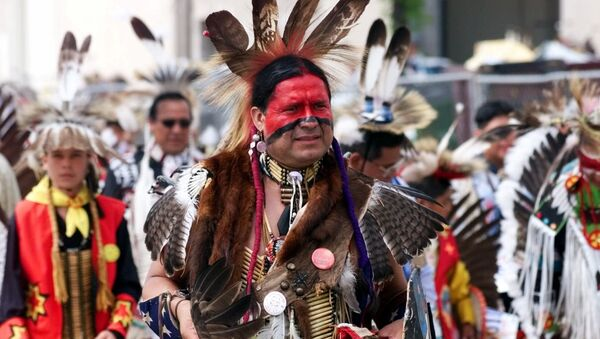 Eddie Two-Clouds, an Apache from Duncan, Okla., marches in the 13th annual Red Earth Festival Parade in downtown Oklahoma City Friday, June 11,1999. - Sputnik International