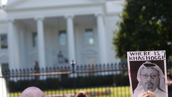 An activist holds an image of missing Saudi journalist Jamal Khashoggi during a demonstration calling for sanctions against Saudi Arabia - Sputnik International