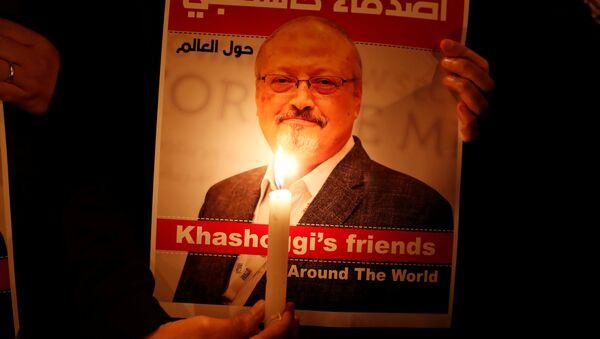 A demonstrator holds a poster with a picture of Saudi journalist Jamal Khashoggi - Sputnik International