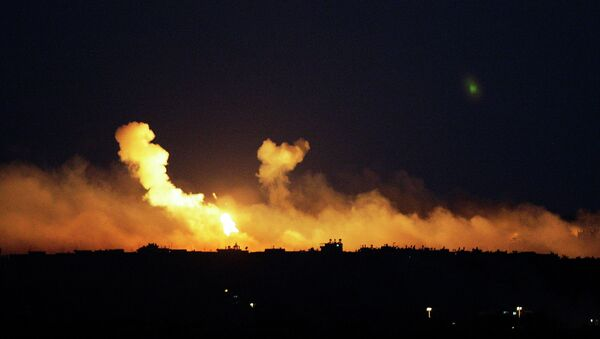 The sky is illuminated by explosions from Israeli military operations over the outskirts of Gaza City as seen from the Israel-Gaza Border. FILE PHOTO - Sputnik International