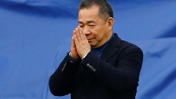 Leicester City chairman Vichai Srivaddhanaprabha reacts as he walks to his helicopter which has landed on the pitch after a game - Sputnik International