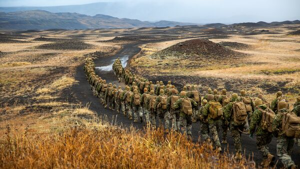 U.S. Marines with the 24th Marine Expeditionary Unit, deployed during Exercise Trident Juncture 18, hike to a cold-weather training site inland in Iceland, October 19, 2018. Picture taken October 19, 2018 - Sputnik International