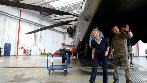 German Defence Minister Ursula von der Leyen is pictured next to a German Bundeswehr armed forces Sikorsky CH-53 helicopter of the Helicopter Wing 64 during her visit at Holzdorf Air Base, south of Berlin, Germany, July 24, 2018 - Sputnik International