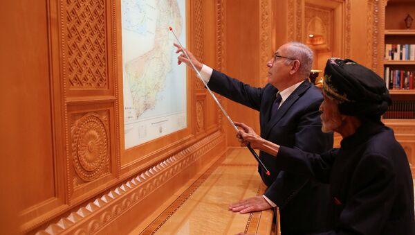 Israeli Prime Minister Benjamin Netanyahu looks at maps with Sultan Qaboos bin Said in this undated handout provided by the Israel Prime Minister Office, in Oman - Sputnik International