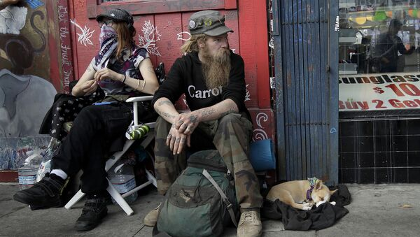 In this Oct. 1, 2018 photo, Stormy Nichole Day, left, sits on a sidewalk on Haight Street with Nord (last name not given) and his dog Hobo while interviewed about being homeless in San Francisco - Sputnik International