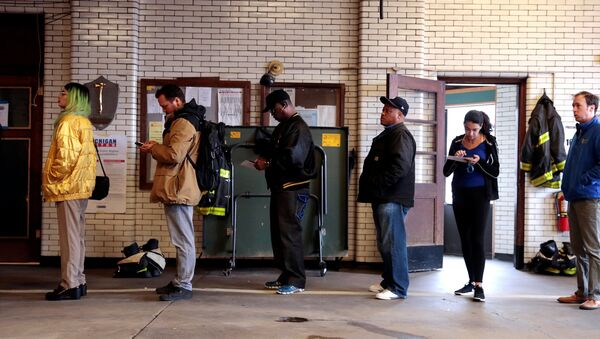 Voters wait to cast their ballots at a fire station serving as a voting place for the midterm election in Detroit - Sputnik International