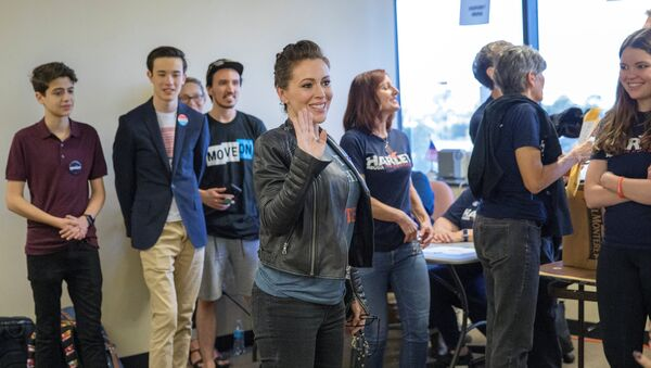 Actor Alyssa Milano visits volunteers at a field office for Congressional District 48 Democratic candidate Harley Rouda on the day of midterm elections, Huntington Beach, California,U.S. November 6, 2018 - Sputnik International