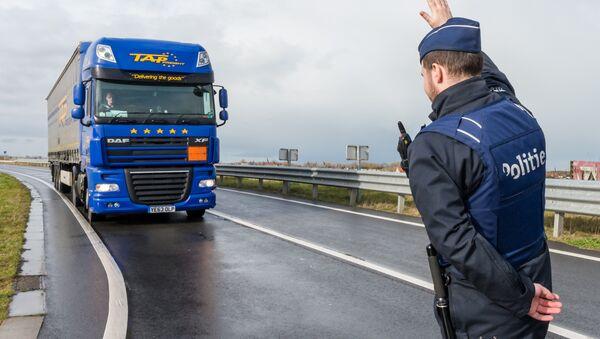 A police man stops a truck on the French-Belgian border in Adinkerke, Belgium, on Wednesday, Feb. 24, 2016. - Sputnik International