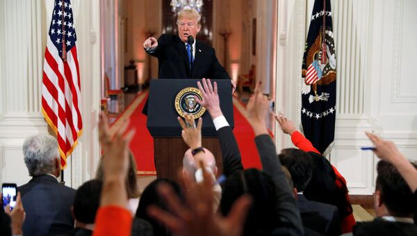 U.S. President Donald Trump points to a questioner while taking questions during a news conference following Tuesday's midterm congressional elections at the White House in Washington, U.S., November 7, 2018 - Sputnik International